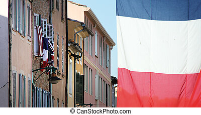 flags in the streets of france blue white and red