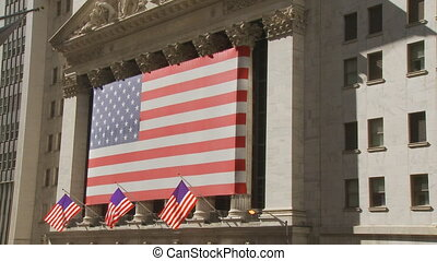 flags in wall street - usa flags on wall street building...