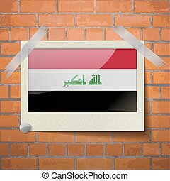 Flags Iraq scotch taped to a red brick wall - Flags of Iraq...