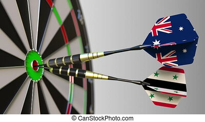 Flags of Australia and Syria on darts hitting bullseye of...