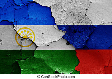 flags of Bashkortostan and Russia painted on cracked wall