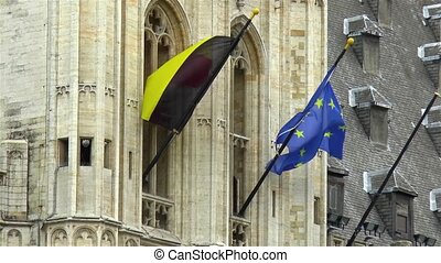 Flags of Belgium and Europe at the Brussels Town Hall building, Grand Place, Belgium.