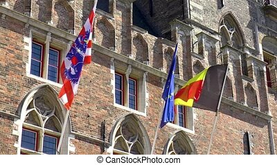 Flags of Belgium, City of Bruges and Europe as displayed at the Bruges Belfry.