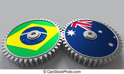 Flags of Brazil and Australia on meshing gears. International cooperation conceptual 3D rendering