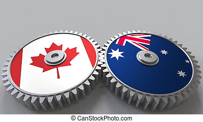 Flags of Canada and Australia on meshing gears. International cooperation conceptual 3D rendering