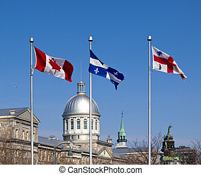 Flags of Canada, Quebec and Montreal in Old Port area of...
