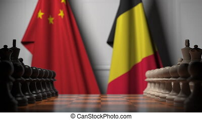 Flags of China and Belgium behind pawns on the chessboard. Chess game or political rivalry related 3D animation