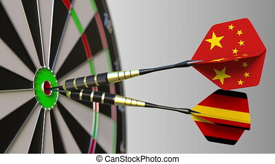 Flags of China and Germany on darts hitting bullseye of the target. International cooperation or competition animation
