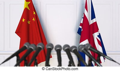 Flags of China and The United Kingdom at international...