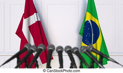 Flags of Denmark and Brazil at international meeting or...