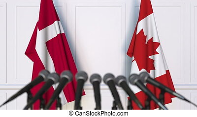 Flags of Denmark and Canada at international meeting or...