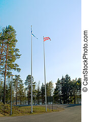 Flags of Denmark and Finland, against the blue sky