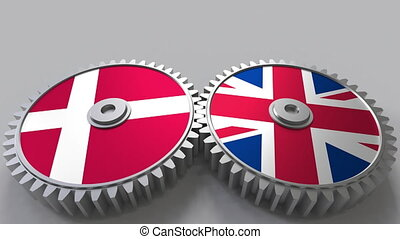 Flags of Denmark and The United Kingdom on meshing gears....