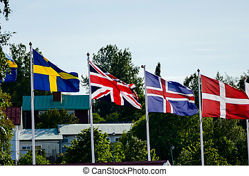 flags of different countries on a background of blue sky, in Sweden Scandinavia North Europe