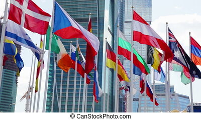 Flags of different countries waving in wind