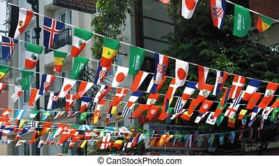 Flags of different Nations in one location. Flags of the States fluttering in the wind on a Sunny day in summer