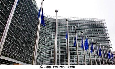 Flags of EU waving in wind near European Parliament