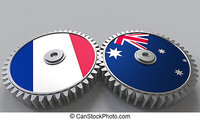 Flags of France and Australia on meshing gears. International cooperation conceptual 3D rendering