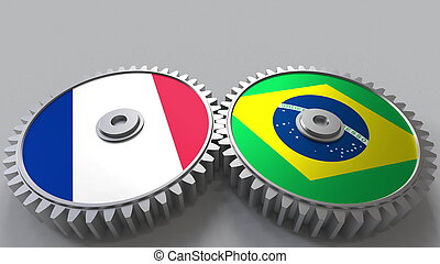 Flags of France and Brazil on meshing gears. International cooperation conceptual 3D rendering