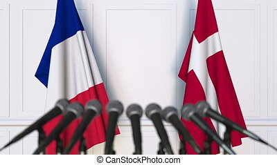 Flags of France and Denmark at international meeting or...