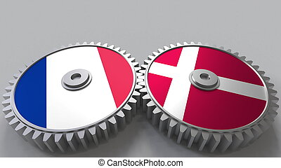 Flags of France and Denmark on meshing gears. International cooperation conceptual 3D rendering