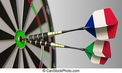 Flags of France and Italy on darts hitting bullseye of the target. International cooperation or competition animation
