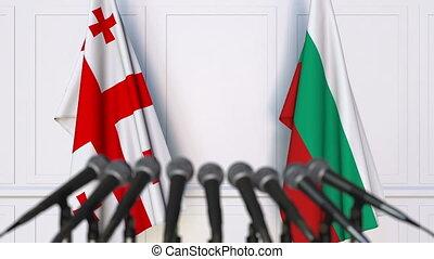 Flags of Georgia and Bulgaria at international meeting or...