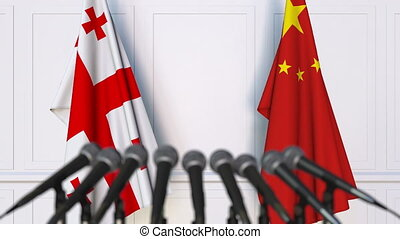 Flags of Georgia and China at international meeting or...