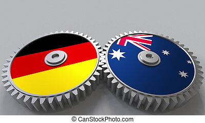 Flags of Germany and Australia on meshing gears. International cooperation conceptual 3D rendering