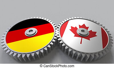 Flags of Germany and Canada on meshing gears. International cooperation conceptual 3D rendering