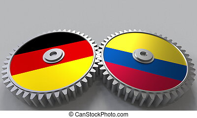 Flags of Germany and Colombia on meshing gears. International cooperation conceptual 3D rendering