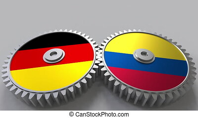 Flags of Germany and Colombia on meshing gears....
