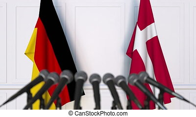 Flags of Germany and Denmark at international meeting or...