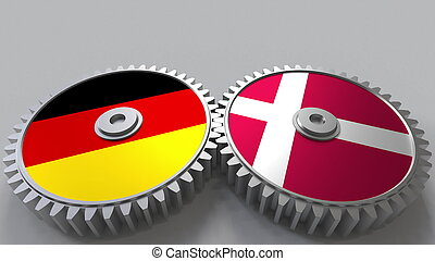 Flags of Germany and Denmark on meshing gears. International cooperation conceptual 3D rendering