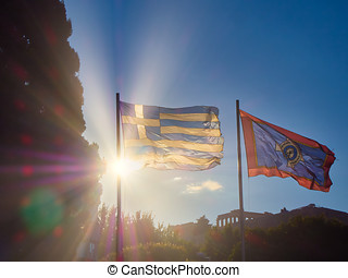 Flags of Greece and Athens waving with Acropolis in background. Athens.