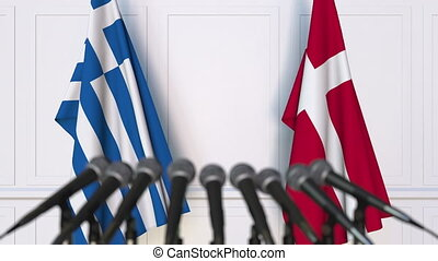 Flags of Greece and Denmark at international meeting or...