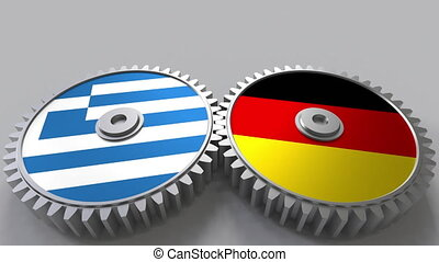 Flags of Greece and Germany on meshing gears. International...
