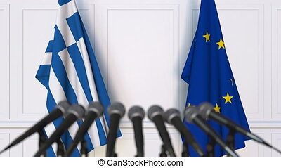 Flags of Greece and the European Union at international meeting or negotiations press conference