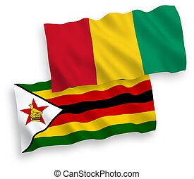 Flags of Guinea and Zimbabwe on a white background - ...