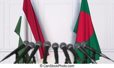 Flags of Hungary and Bangladesh at international meeting or...