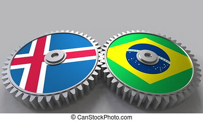 Flags of Iceland and Brazil on meshing gears. International...