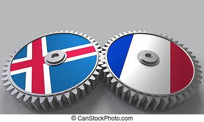Flags of Iceland and France on meshing gears. International cooperation conceptual 3D rendering