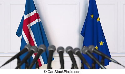 Flags of Iceland and the European Union at international meeting or negotiations press conference