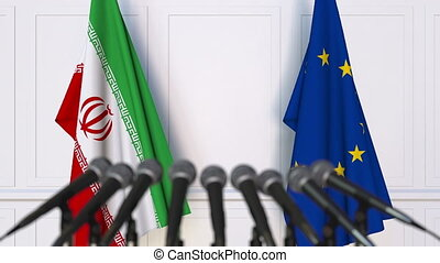 Flags of Iran and the European Union at international meeting or negotiations press conference
