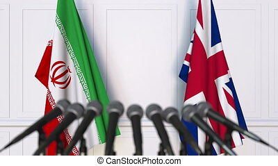 Flags of Iran and the United Kingdom at international...