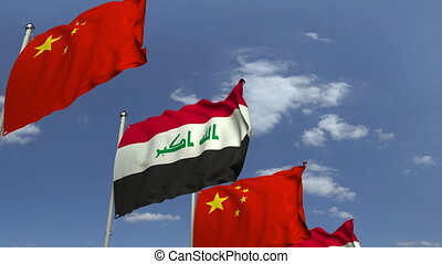 Flags of Iraq and China at international meeting, loopable...