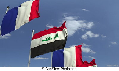 Flags of Iraq and France at international meeting, loopable...