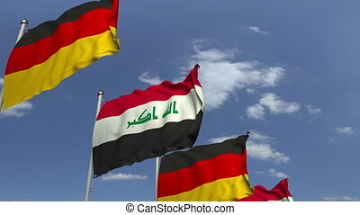 Flags of Iraq and Germany at international meeting, loopable...
