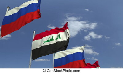 Flags of Iraq and Russia at international meeting, loopable...
