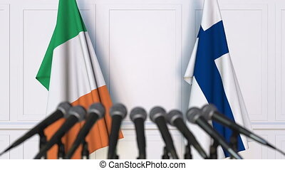 Flags of Ireland and Finland at international meeting or...